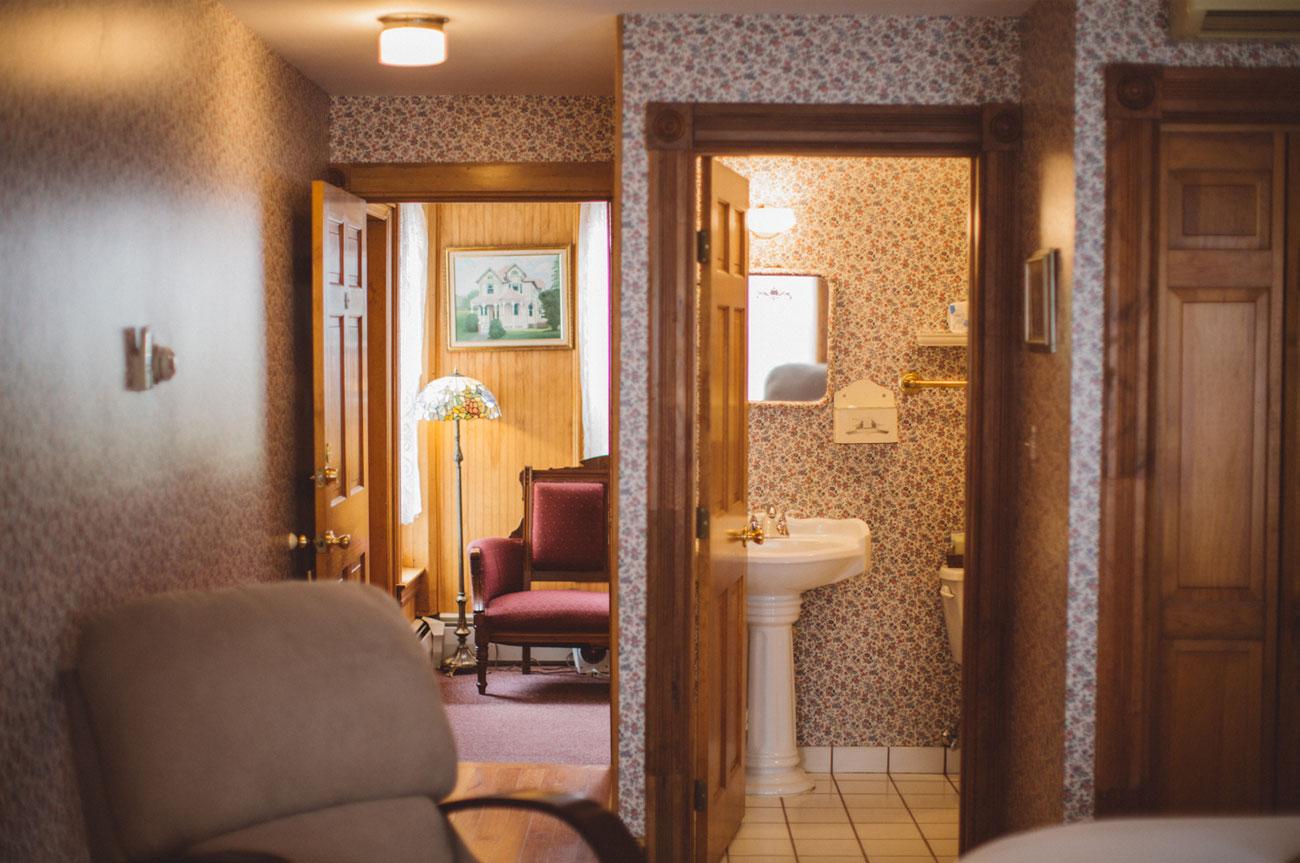 Bathroom and Living Room Room 1 | AlbergoAllegriaHotelandbreakfastrestaurant | Windham NY