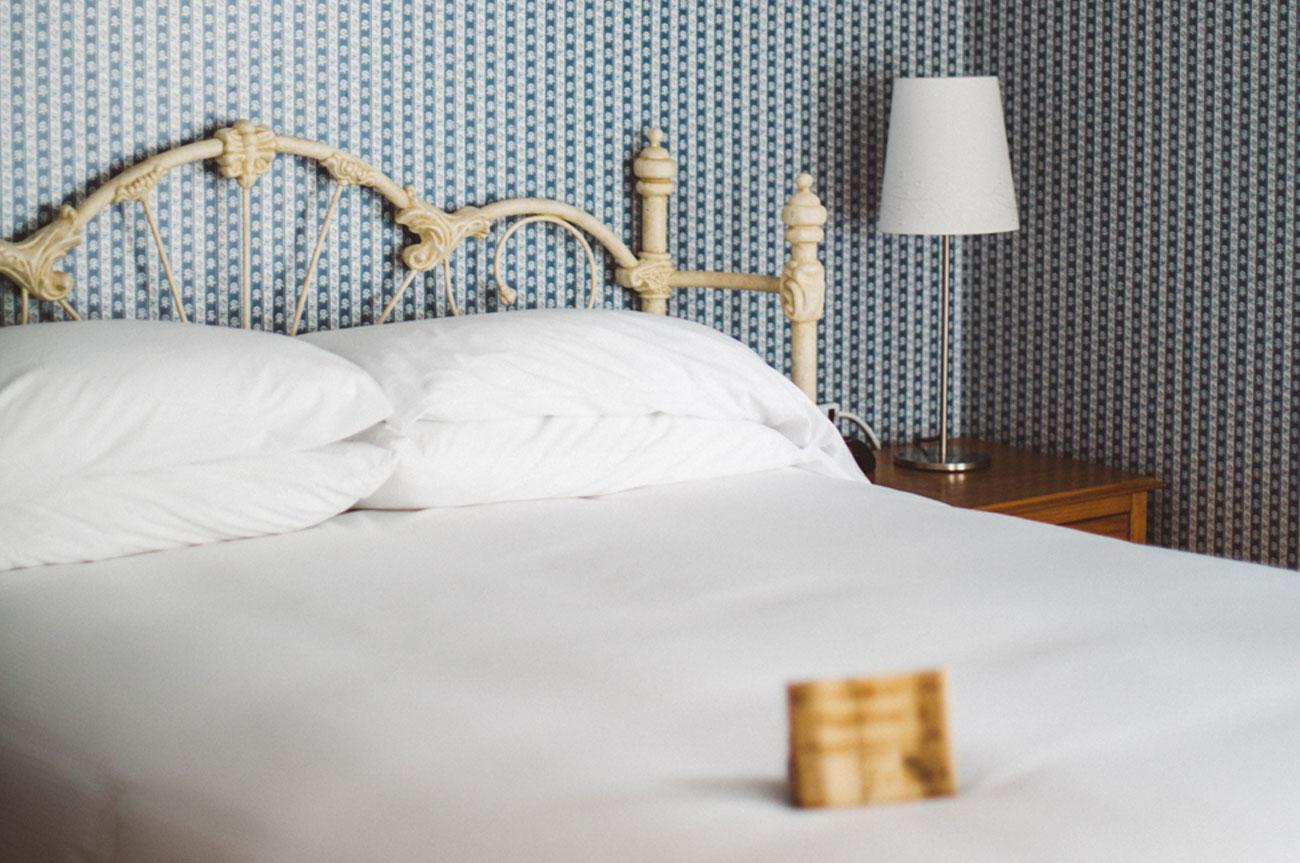 Bed Side View Room 13 | AlbergoAllegriaHotelandbreakfastrestaurant | Windham NY