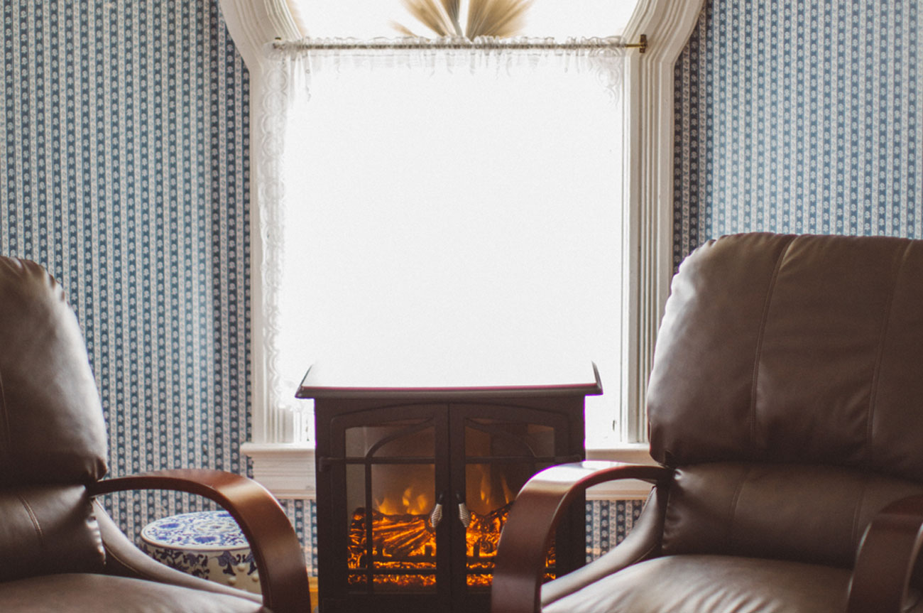 Fireplace with Chairs Room 13 | AlbergoAllegriaHotelandbreakfastrestaurant | Windham NY