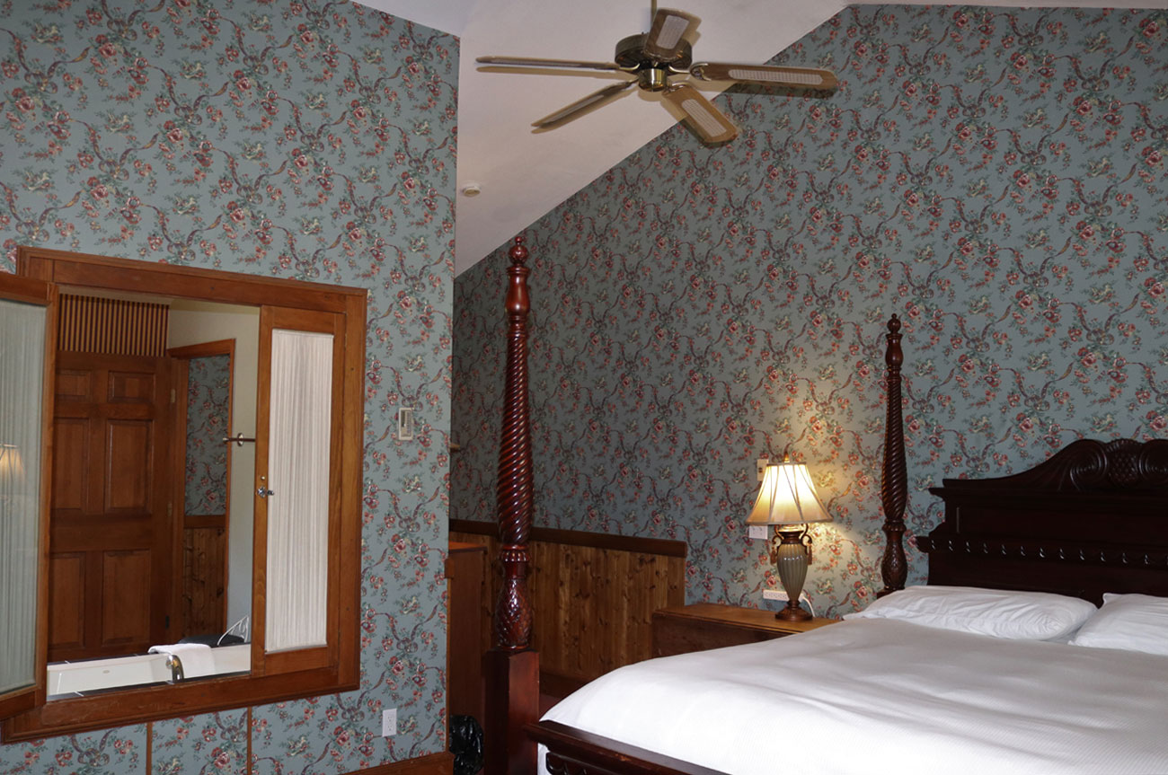 Main Bed and Ceiling Fan Room 19 | AlbergoAllegriaHotelandbreakfastrestaurant | Windham NY